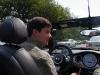 Matt driving out little yellow Mini Cooper convertible in downtown Washington DC.