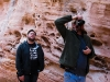 Nathan and John walking and photographing in a tunnel in the Valley of Fire State Park in Nevada.