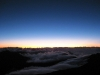 Watching the sun rise from above the clouds at Haleakala on Maui.