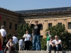 This guy is a Rocky Fan. He is wearing a Rocky t-shirt standing at the top of the Rocky stairs doing the Rocky pose.