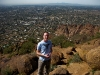 Me with a scenic view of Phoenix from the top of Camelback Mountain.